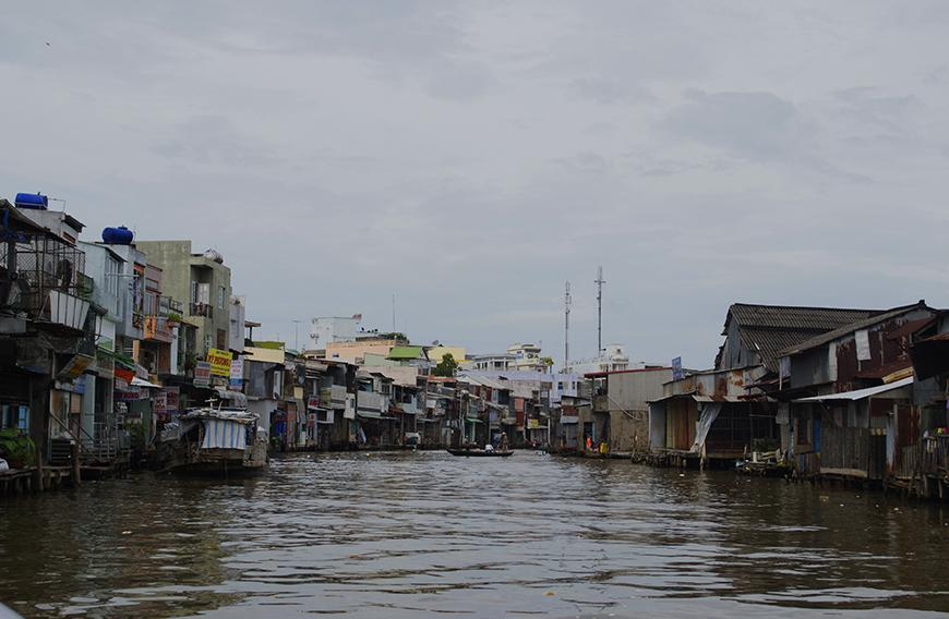 informal housing settlement built on a river in Vietnam